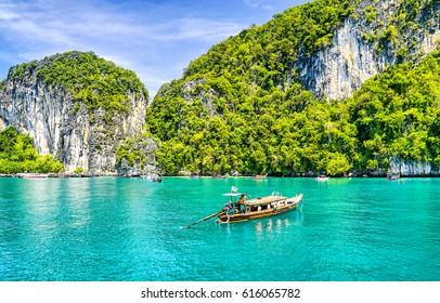 Phuket beach boat on Thailand landscape