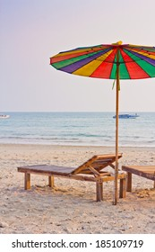 PHUKET clear beach with color umbrella evening time