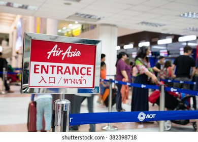 PHUKET ISLAND, THAILAND - CIRCA FEBRUARY, 2015: People stand on the registration of the company AirAsia in Phuket International Airport. Airport plays an important role in tourism industry Thailand