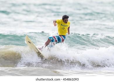 PHUKET - JULY 17: unidentified surfer in action catching waves in rainy season at Kata beach Phuket on July 17, 2016 in Kata beach, Phuket, Thailand.
