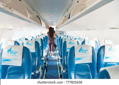 PHUKET, THAILAND - 24 APR 2017: Bangkok airways airplane interior with leaving passengers on background