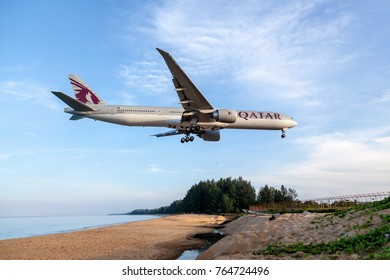 Phuket Thailand 25 Nov 2017 : Qatar airways  Boeing 777-300ER was landing to airport and passsing Mai Kao Beach which the famous beach of Phuket.