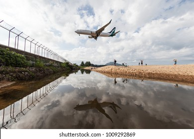 Phuket Thailand 6 Jan 18: Silk Air Boeing 737 max 8 was descending to Phuket international airport when some people was travelling on the beach.