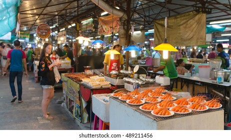 PHUKET, THAILAND - 9 APR 2016: Thai food stall with seafood on weekend night market in Phuket town.