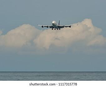 Phuket, Thailand - Apr 25, 2018. A Boeing 747-400 airplane of Thai Airways landing at Phuket International Airport (HKT).