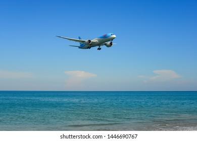 Phuket, Thailand - Apr 4, 2019. G-TUIJ TUI Airways Boeing 787-9 Dreamliner landing above the sand beach near Phuket Airport (HKT).