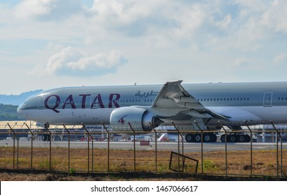 Phuket, Thailand - Apr 5, 2019. Qatar Airways A7-BAZ (Boeing 777-300ER) taxiing on runway of Phuket Airport (HKT).
