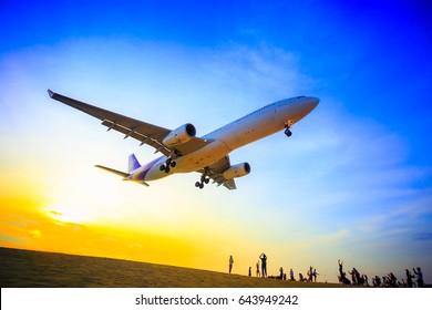 Phuket, Thailand - April 11, 2017:Tourists taking photo with plane on beach airport of Phuket, Thailand
