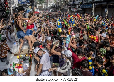 Phuket, Thailand, April 13, 2017 - Songkran festival revelers participate in a massive street party on Bangla Road in Phuket, Thailand. The Songkran festival celebrates the Thai New Year.