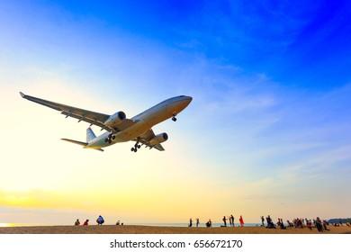 Phuket, Thailand - April 14, 2017:Tourists taking photo with plane on beach airport of Phuket, Thailand