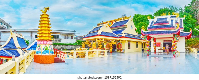 PHUKET, THAILAND - APRIL 30, 2019: Panorama of Sam Sae Chu Hut Chinese Shrine with small halls, multi-tired roofs, numerous dragon columns and gilt firecracker pagoda, on April 30 in Phuket