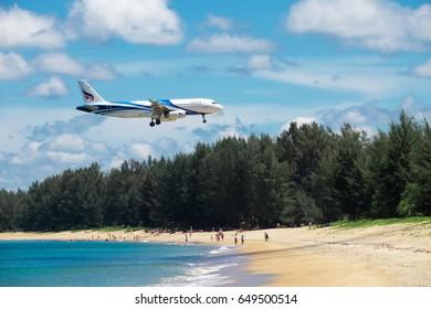 PHUKET, Thailand - April 8th, 2017 : Bangkok Airways airplane on the sky landing at Phuket International Airport, Mai Khao Beach, Phuket province, Southern of Thailand.
