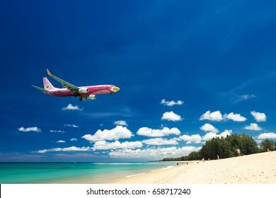 PHUKET, Thailand - April 8th, 2017 : Nokair airways airplane landing at Phuket International Airport, Mai Khao Beach, Phuket province, Southern of Thailand.