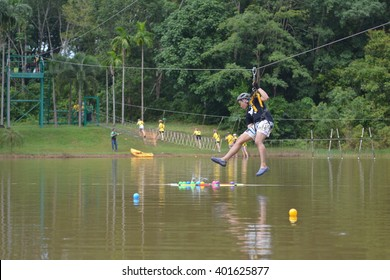 PHUKET THAILAND - AUGUST 1 : Young people playing on a zip line base, An activity in a water on August 1, 2015 in Phuket Thailand