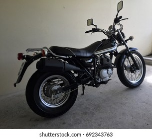 PHUKET, THAILAND - AUGUST 7, 2017: A black Japanese racing motorcycle parks in a garage.