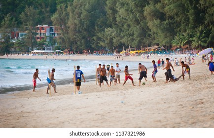 PHUKET, THAILAND - CIRCA MAR 2013: Group of Thais have fun in their free time playing football right on the beach