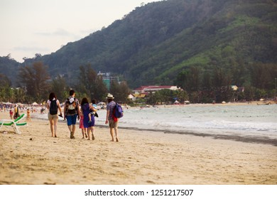 Phuket, Thailand, Circa Mar 2013 - Group of tourists back to their hotel after sunbathing