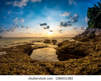 PHUKET, THAILAND - CIRCA MARCH 2018: Spectacular view on the rocks of Surin Beach during sunset circa March, 2018 in Phuket, Thailand.