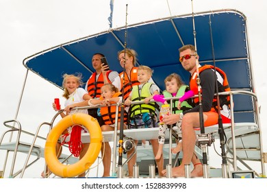 Phuket Thailand - Dec 2017:  Happy tourists during sea fishing on professional fishing boat, Thailand. Powerful trolling rods and reels, large bait for big trophy fish, powerful longboat and good mood