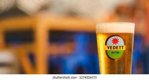 PHUKET, THAILAND - DEC 25, 2018: glass of cold vedett beer on bar counter, ready to serve