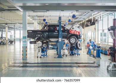 PHUKET, THAILAND - DECEMBER 1 : Car technician repairing car in workshop service station in Phuket on December 1, 2017. The official dealer of Toyota, who is the top market share for commercial car