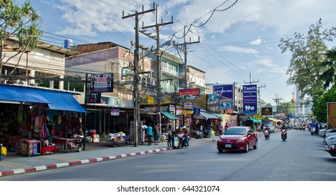 Phuket, Thailand â?? December 12, 2015: People drive along the beach road in Phuket. Phuket, a rain-forested, mountainous island in the Andaman Sea, has some of Thailandâ??s most popular beaches.