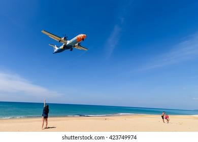 Phuket, Thailand - December 21, 2015 : Girl is watching landing Bangkok air airplane at phuket airport