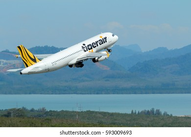 Phuket, Thailand, December 25, 2016. Tigerair Airbus A320-232 Reg. 9V-TAO Taking Off from Phuket International Airport with Sea and Mountain Background. Set as Copy Space for Text.