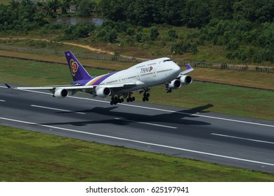 Phuket, Thailand. December 25, 2016. Thai Airways International Boeing 747-400 Airborne Taking Off from Phuket International Airport with Shadow. Copy Space for Text.