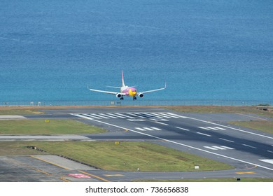 Phuket, Thailand. December 25, 2016. Nok Air Boeing 737-800 on Short Final Approaching for Landing at Phuket International Airport with Sea Beach Background.