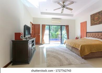 Phuket, Thailand - Feb 2020: Typical interior of luxury villa. White walls, modern architecture, open plan, lots of light, minimal furniture, bright lights, big window. Phuket island, Thailand