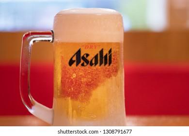 PHUKET, THAILAND - FEB 7, 2019: chilled asahi beer mug on table, asahi is one of favorite japan beer