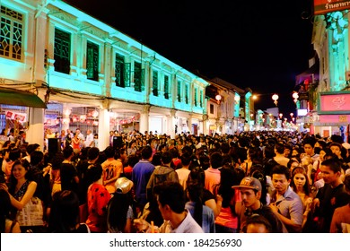 PHUKET, THAILAND - FEBRUARY, 08. 2014: people walking down Thalang Road at The Old Phuket Town Festival on February, 08th 2014 in Phuket, Thailand
