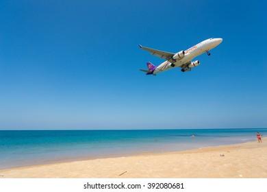 Phuket - Thailand - February 23,2016 :Thai Airways airplane is landing at Phuket airport over the Mai Khao beach in Thailand