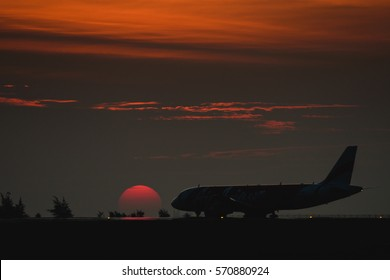 Phuket, THAILAND - Febuary 2, 2017: Airliner Air-Asia Airbus A320 taxi for parking at Phuket airport with beautiful sunset behind