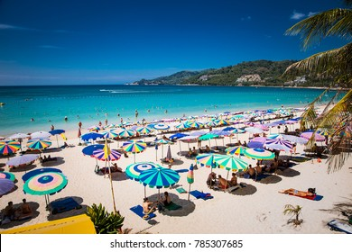 PHUKET, THAILAND- JAN 23, 2016: Crowds of tourists at Patong beach on  Jan 23, 2016 in Phuket, Thailand. Phuket is a popular destination famous for its beaches.