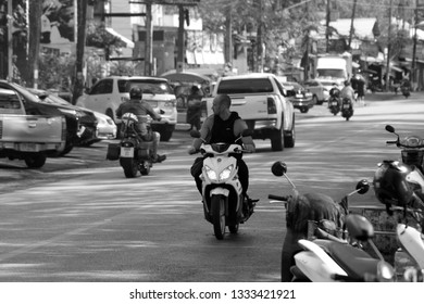 PHUKET, THAILAND - JANUARY 06, 2018: Road with cars on the streets of Rawai beach. Phuket