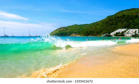 PHUKET, THAILAND - JANUARY 06.2018: People relax on Nai Harn beach. This is one of the most popular beaches among tourists in Phuket.