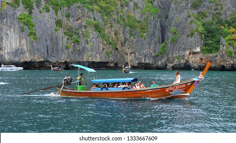 PHUKET, THAILAND - JANUARY 07, 2018: Traditional thai boat with tourists moving to Phi Phi island, Krabi Province, Andaman Sea