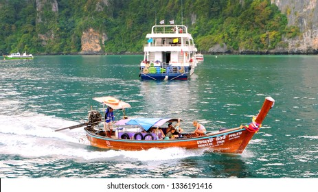 PHUKET, THAILAND - JANUARY 07,2018: Traditional thai boat with tourists moving to Phi Phi island, Krabi Province, Andaman Sea.
