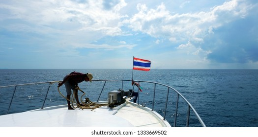 PHUKET, THAILAND - JANUARY 08, 2018: Speed boat with flag of Thailand on the background the blue sea. Andaman Sea. Thailand