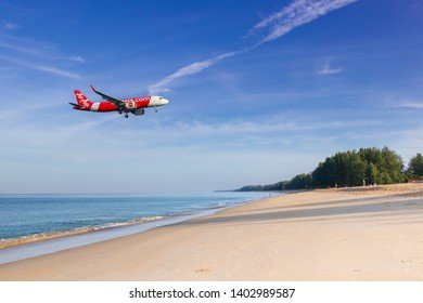 Phuket, Thailand. January 11, 2019. Thai AirAsia Airbus A320neo Reg. HS-BBY over Mai Kao Beach on Short Final approach for Landing at Phuket International Airport.