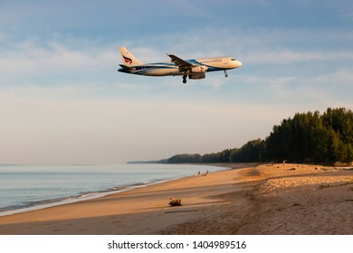 Phuket, Thailand. January 11, 2019. Bangkok Airways Airbus A320-200 Reg. HS-PPJ over Mai Kao Beach on Short Final for Landing at Phuket International Airport on Morning.