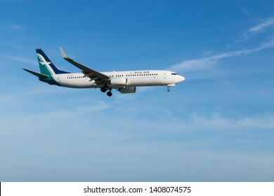 Phuket, Thailand. January 11, 2019. SilkAir Boeing 737-800 Reg.9V-MGP on Short Final Approach for Landing at Phuket International Airport with Blue Sky.