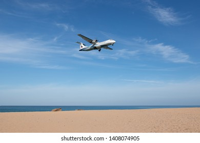 Phuket, Thailand. January 11, 2019. Bangkok Airways ATR 72-500 Reg. HS-PZA over Mai Kao Sea Beach on Short Final Approach for Landing at Phuket International Airport with Blue Sky.