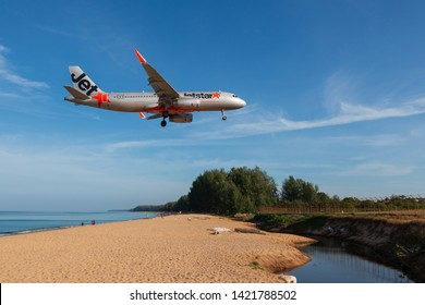 Phuket, Thailand. January 11, 2019. Jetstar Asia Airbus A320-200 Reg. 9V-JSQ over Mai Kao Beach on Short Final Approach for Landing at Phuket International Airport with Blue Sky.