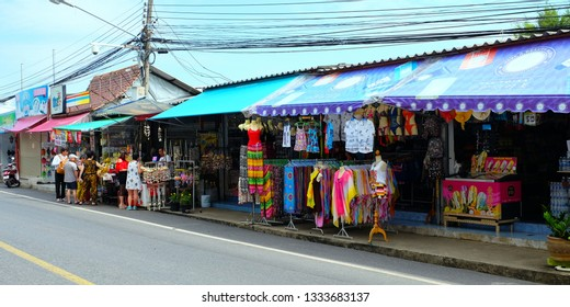 PHUKET, THAILAND- JANUARY 11.2018:  Asian tourists go shopping on the street market in Phuket.