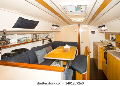 Phuket, Thailand - January 2019: Modern interior of sailing yacht - saloon, galley and skipper place. Light and positive interior of a luxury yacht with wood and plastic trim, lots of light
