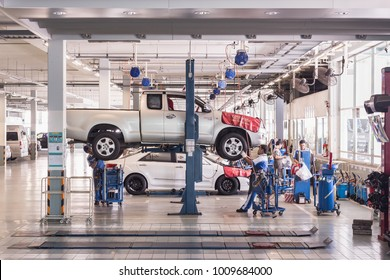 PHUKET, THAILAND - JANUARY 25 : Car technician repairing car in workshop service station in Phuket on January 25, 2018. The official dealer of Toyota, who is the top market share for commercial car