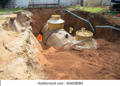 PHUKET, THAILAND - JULY 17, 2016: Workers are digging the ground to install underground fuel tank on July 17, 2016 in Phuket, THAILAND